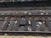 Trash litter on New York City subway track royalty free stock image
