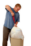 Trash Man. A man lifting a trash bag out of a domestic trash container, ready to take out. Isolated on white stock images