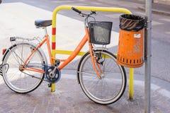 Trash metal orange waste and bicycle Stock Image