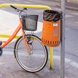 Trash metal orange waste and bicycle Royalty Free Stock Photography