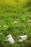 Trash Over nature rubbish among bushes and trees in littered park royalty free stock image