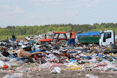 Trash pickup on the dumping ground garbages. Trash pickup at work on the dump - Szadolki - Gdansk Stock Photography