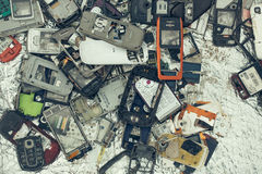 Trash pile of old mobile phones Royalty Free Stock Photo