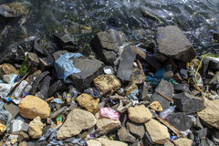 Trash polluting water. Many trash polluting river water Stock Images