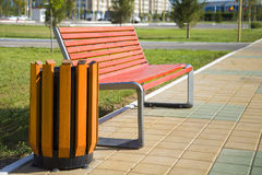 Trash Receptacle and bench. Container for garbage and a bench in the park Royalty Free Stock Photography