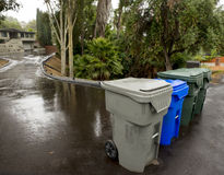 Trash, Recycling and Green Leaf Bins on the Street royalty free stock photography