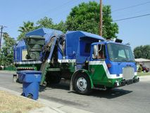 Trash and Recycling Truck. Automated refuse collection truck in Southern California Royalty Free Stock Photos