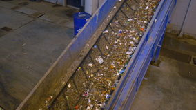 Trash, rubbish conveyor on a waste recycling plant. 4K stock video