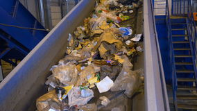 Trash, rubbish, litter on a working sorting conveyor belt in a recycling plant. stock video footage