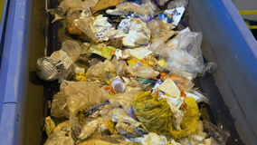 Trash, rubbish, litter on a working sorting conveyor belt in a recycling plant. stock video