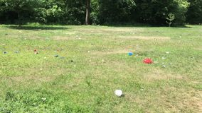 Trash scattered around public park after festival in Berlin stock footage