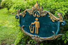 A trash spot sign in the park. A trash spot sign in the public park Royalty Free Stock Image