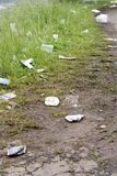 Trash spread on wayside Royalty Free Stock Images