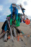 Trash statue on beach. A statue made of trash found on the beach Stock Image