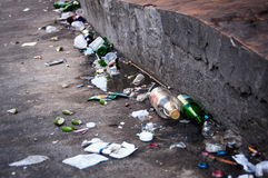Trash in the street, empy beer bottles Stock Images
