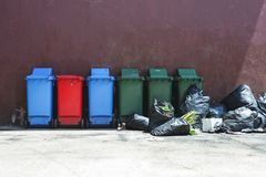Trash and trash bin are overflowing. stock images