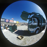 A trash truck. Unloading a garbage container royalty free stock photos