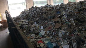 Trash Waiting To Be Recycled (2 of 3). A dumpster of trash at the recycle center stock footage