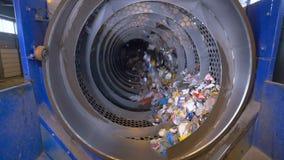 Trash in a waste sorting machine, barrel at a recycling plant. No people. Trash in a waste sorting machine at a recycling plant. No people. 4K stock video