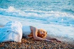 Trash the wedding dress Stock Photo