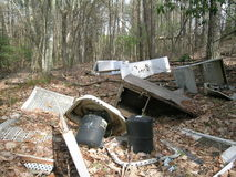Trash in woods. Residential/light industrial trash in summer woodland Royalty Free Stock Photos