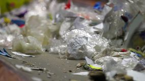 Trash workers weeding through recyclables. Manual sorting of waste plastic in a Mixed Waste Processing Facility. Modern techniques of recycling does not exclude stock footage