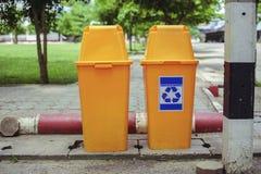 Trash yellow bin plastic Stock Image