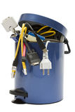 Trashcan with electronic waste. Small trashcan with electronic waste on white background royalty free stock photos