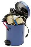 Trashcan with electronic waste. Small trashcan with electronic waste on white background stock images