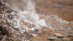 Trashcan. Evaporation of waste to landfill stock video footage