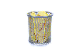 Trashcan full of crumpled paper Royalty Free Stock Photo
