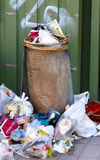 Trashcan with lots of garbage Royalty Free Stock Image
