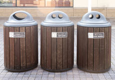 Trashcan that separate waste into three part Stock Photos