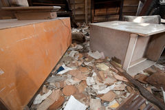 Trashed Furniture. Trashed room in an old abandoned house Royalty Free Stock Photography