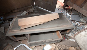 Trashed Furniture In Room. Trashed room in an old abandoned house Stock Photography