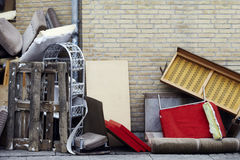 Trashed furnitures on the sidewalk. Broken furniture left on pavement Royalty Free Stock Photos
