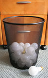 Trashed ideas. Waste basket with discarded light bulbs Stock Photos