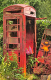 Trashed UK phone box. An image of a vandalised, derelict phone box, generic to the uk. Could also be a metaphor for the British communication industry Stock Photos