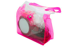 Trasparent cosmetics bag with mirror and comb Royalty Free Stock Images