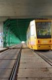 Trasport by tram. Transport by tram under bridge in Warsaw stock image