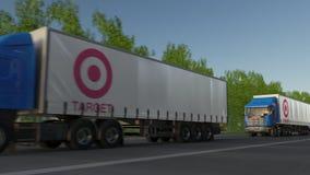 Trasporti i camion dei semi con il logo di Target Corporation che guida lungo il sentiero forestale Rappresentazione editoriale 3 fotografia stock libera da diritti