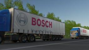 Trasporti i camion dei semi con il logo Gmbh di Robert Bosch che guida lungo il sentiero forestale Rappresentazione editoriale 3D Fotografia Stock