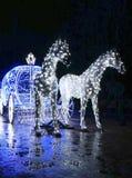 Trasporto decorativo con i cavalli decorati con le luci Fotografie Stock Libere da Diritti