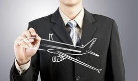 Trasporto dell'aereo di tiraggio dell'uomo di affari fotografia stock