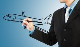 Trasporto dell'aereo di tiraggio dell'uomo di affari immagini stock