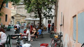 Trastevere market. ROME, ITALY - JULY 7, 2015: People in the crowded streets of Trastevere passing along an open market stock video