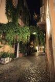 Trastevere, Rom, Italien - 10. Juli 2017: Trastevere-Kopfsteinstraße Lizenzfreies Stockfoto