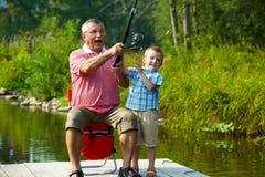 Trastos de pesca que lanzan Foto de archivo