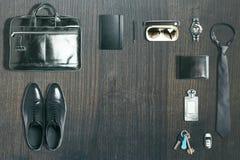 Trastos del negocio en la madera oscura Foto de archivo libre de regalías