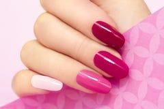 Tratamento de mãos no rosa Imagens de Stock Royalty Free